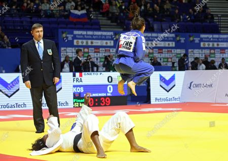 Gold Medalist Majlinda Kelmendi of Kosovo (blue) Celebrates Her Victory Over Priscilla Gneto of France in the Women's -52 Kg Category Final Bout at the European Judo Championships at the Tatneft Arena in Kazan Russia 21 April 2016 Russian Federation Kazan