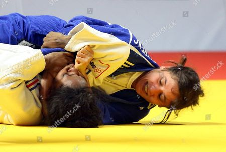 Priscilla Gneto of France (white) in Action Against Agata Perenc of Poland (blue)during Their Women's -52 Kg Category Elimination Bout at the European Judo Championships at the Tatneft Arena in Kazan Russia 21 April 2016 Russian Federation Kazan