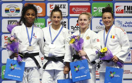 (l-r) Silver Medalist Priscilla Gneto of France Gold Medalist Majlinda Kelmendi of Kosovo and Bronze Medalists Yulia Ryzhova of Russia Andreea Chitu of Romania Pose on the Podium During the Women's - 52 Kg Category Medal Ceremony of the European Judo Championships at the Tatneft Arena in Kazan Russia 21 April 2016 Russian Federation Kazan