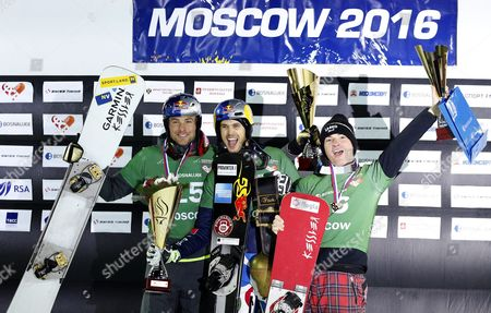 (l-r) Second Placed Benjamin Karl of Austria Winner Roland Fischnaller of Italy and Third Placed Rok Marguc of Slovenia Pose on the Podium of the Men's Parallel Slalom Competition at the Fis Snowboard World Cup 2016 in Moscow Russia 30 January 2016 Russian Federation Moscow