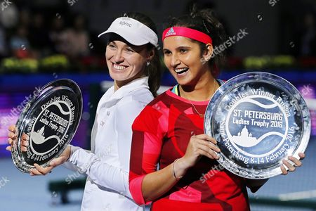 Martina Hingis (l) of Switzerland and Sania Mirza (r) of India Pose with Their Trophies After Defeating Russia's Vera Dushevina and Barbora Krejckova of the Czech Republic in Their Doubles Final of the St Petersburg Ladies Trophy 2016 Tennis Tournament in St Petersburg Russia 14 February 2016 Russian Federation St.petersburg