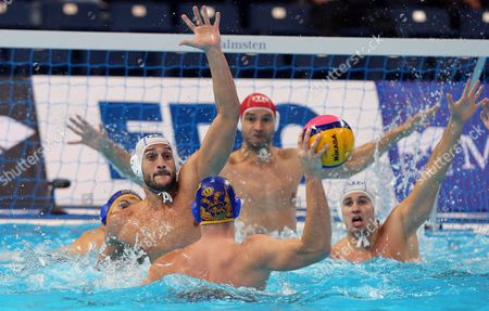 Mladjan Janovic (front) of Montenegro in Action Against Valentino Gallo (l) of Italy During the Quarter Final Match Italy Vs Montenegro at the Water Polo European Championships in Belgrade Serbia 19 January 2016 Serbia and Montenegro Belgrade