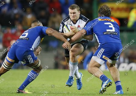 Nizaam Carr (l) and Frans Malherbe (r) From the Stormers of South Africa Tackle Tom Robertson (c) From the Waratahs of Australia During Their Super Rugby Match at Newlands Stadium in Cape Town South Africa 30 April 2016 South Africa Cape Town