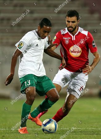 Etoile Sportive Du Sahel Player Hamdi Nagguez (r) and Al Ahly Tripoli Player Elmahdi Elmassri (l) Fight For the Ball During the Caf Confederation Cup Soccer Match Between Etoile Sportive Du Sahel of Tunisia and Al Ahly Tripoli of Libya at the Olympique Stadium in Sousse Tunisia 16 July 2016 Tunisia Sousse