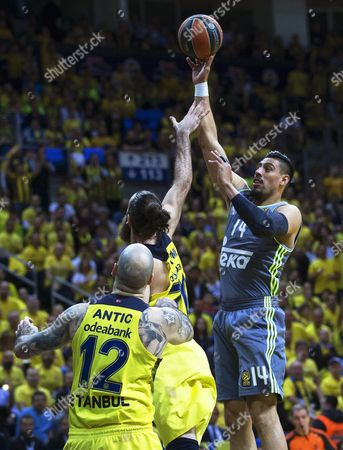 Real Madrid's Gustavo Ayon (r) in Action Against Fenerbahce Players Luigi Datome (c) and Pero Antic (l) During the Euroleague Playoff Basketball Match Between Fenerbahce Istanbul and Real Madrid in Istanbul Turkey 14 April 2016 Turkey Istanbul