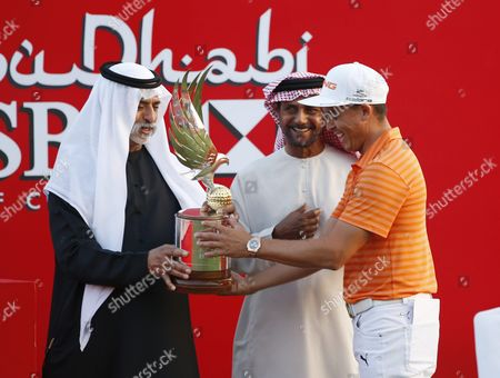 Rickie Fowler (r) of the Usa Receives the Winner's Trophy From Hh Sheikh Nahyan Bin Mubarak Al Nahyan (l) at the Abu Dhabi Hsbc Golf Championship 2016 in Abu Dhabi United Arab Emirates 24 January 2016 United Arab Emirates Abu Dhabi
