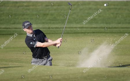 Michael Hoey of Ireland Hits out of a Bunker During the First Round of the Omega Dubai Desert Classic 2016 Golf Tournament at Emirates Golf Club in Dubai United Arab Emirates 04 February 2016 United Arab Emirates Dubai