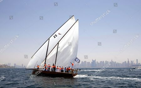 Vrew Members of the 'Zilzal' Dhow Boat Owned by H H Sheikh Hamdan Bin Mohammed Bin Rashid Al Maktoum Crown Prince of Dubai and Chairman of Dubai Executive Council Celebrate After Winning the Al Gaffal Dhow Race in Dubai United Arab Emirates 20 May 2016 the Al Gaffal Traditional 60ft Dhow Race is the Biggest Traditional Sailing Race in the World and Sees Traditional Dhow Sailing Vessels Taking Part the Race Begins From Sur Bu Na'air Island Off the Coast of the Uae Heads East Towards the First Check Point at Moon Island 23 60 Nautical Miles From the Start Line and Then Changes Course Slightly For the Final 27 30 Nautical Miles to the Finish Line at Mina Seyahi in the Dubai International Marine Club (dimc) United Arab Emirates Dubai