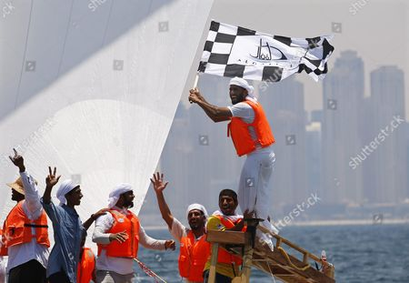 Crew Members of the 'Zilzal' Dhow Boat Owned by H H Sheikh Hamdan Bin Mohammed Bin Rashid Al Maktoum Crown Prince of Dubai and Chairman of Dubai Executive Council Celebrate After Winning the Al Gaffal Dhow Race in Dubai United Arab Emirates 20 May 2016 the Al Gaffal Traditional 60ft Dhow Race is the Biggest Traditional Sailing Race in the World and Sees Traditional Dhow Sailing Vessels Taking Part the Race Begins From Sur Bu Na'air Island Off the Coast of the Uae Heads East Towards the First Check Point at Moon Island 23 60 Nautical Miles From the Start Line and Then Changes Course Slightly For the Final 27 30 Nautical Miles to the Finish Line at Mina Seyahi in the Dubai International Marine Club (dimc) United Arab Emirates Dubai