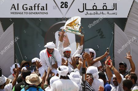 Crew Members of the 'Zilzal' Dhow Boat Owned by H H Sheikh Hamdan Bin Mohammed Bin Rashid Al Maktoum Crown Prince of Dubai and Chairman of Dubai Executive Council Celebrate with the Trophy After Winning the Al Gaffal Dhow Race in Dubai United Arab Emirates 20 May 2016 the Al Gaffal Traditional 60ft Dhow Race is the Biggest Traditional Sailing Race in the World and Sees Traditional Dhow Sailing Vessels Taking Part the Race Begins From Sur Bu Na'air Island Off the Coast of the Uae Heads East Towards the First Check Point at Moon Island 23 60 Nautical Miles From the Start Line and Then Changes Course Slightly For the Final 27 30 Nautical Miles to the Finish Line at Mina Seyahi in the Dubai International Marine Club (dimc) United Arab Emirates Dubai