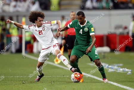 Saudi Player Abdulla Al-dossary (r) Fights For the Ball with Omar Abdul-rahman (l) Player of United Arab Emirates (uae) During the Fifa World Cup 2018 Asian Qualifying Group a Soccer Match Between Uae and Saudi Arabia at Mohammed Bin Zayed Stadium- Aljazira Club in Abu Dhabi United Arab Emirates on 29 March 2016 United Arab Emirates Abu Dhabi