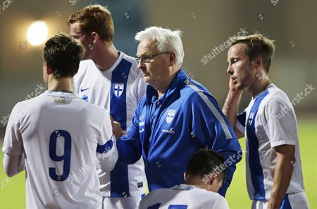 Finnish National Soccer Team's Swedish Head Coach Hans Backe (c) Shakes Hands with His Players After the International Friendly Soccer Match Between Finland and Iceland at Armed Forces Stadium in Abu Dhabi United Arab Emirates 13 January 2016 Iceland Won 1-0 United Arab Emirates Abu Dhabi