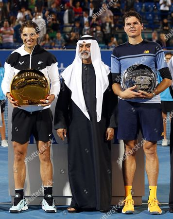 Spain's Rafael Nadal (l) Poses with His Trophy Next to Sheikh Nahyan Bin Mubarak Al Nahyan (c) Head of the Uae Ministry of Culture Youth and Social Development After Defeating Milos Raonic (r) of Canada in Their Final Match of the Mubadala World Tennis Championship in Abu Dhabi United Arab Emirates 02 January 2016 United Arab Emirates Abu Dhabi