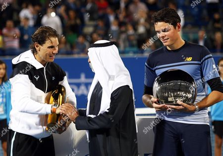 Spain's Rafael Nadal (l) is Congratulated by Sheikh Nahyan Bin Mubarak Al Nahyan (c) Head of the Uae Ministry of Culture Youth and Social Development After Defeating Milos Raonic (r) of Canada in Their Final Match of the Mubadala World Tennis Championship in Abu Dhabi United Arab Emirates 02 January 2016 United Arab Emirates Abu Dhabi