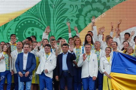 Ukrainian Prime Minister Volodymyr Groysman (c) Sergey Bubka (c-r) Ukraines Noc President and Ioc Eb Member Waves with the National Olympic Team of Ukraine During Their Sending Off Ceremony on the St Sophia Square in Kiev Ukraine 23 July 2016 Today Ukrainian Team is Departing to the Training Camp in Preparation For the 2016 Rio Olympic Games Which Will Be Held From 05 to 21 August in Rio De Janeiro Brazil Ukraine Kiev