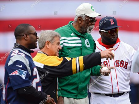 Boston Red Sox Designated Hitter David Ortiz (r) Walks Off the Field with Former New England Patriot Ty Law (l) Former Boston Bruins Bobby Orr (2-l) and Former Boston Celtic Bill Russell (2-r) During Pre-game Ceremonies Before the Game Between the Boston Red Sox and the Baltimore Orioles at Fenway Park in Boston Massachusetts Usa 11 April 2016 This is the Final Mlb Season For the Retiring David Ortiz After Joining the Boston Red Sox in 2003 United States Boston