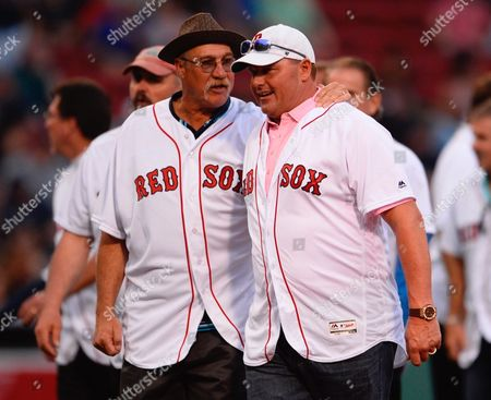 Former Boston Red Sox Dave Stewart (l) Talks with Former Teammate Roger Clemens (r) on the Field Before the Game Against the Colorado Rockies During a Recognition Ceremony For the 1986 American League Pennant Team at Fenway Park in Boston Massachusetts Usa 25 May 2016 United States Boston