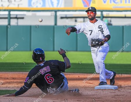 Chicago White Sox Shortstop Jimmy Rollins (r) Throws to First Base After Forcing out Cleveland Indians Center Fielder Marlon Byrd (l) to Turn a Double Play on Cleveland Indians Shortstop Michael Martinez in the Seventh Inning of Their Mlb Game at Us Cellular Field in Chicago Illinois Usa 23 May 2016 United States Chicago