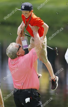 Fuzzy Zoeller of the Us Hoists a Young Patron That He Brought out of the Crowd to Putt For Him on the Ninth Hole During the Par 3 Contest at the 2016 Masters Tournament at the Augusta National Golf Club in Augusta Georgia Usa 06 April 2016 the Masters Tournament is Held 07 April Through 10 April 2016 United States Augusta