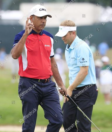 Stock Photo of Jeev Milkha Singh of India (l) Reacts After Sinking His Putt on the Fourth Hole During the Continuation of the First Round at 116th Us Open Championship at Oakmont Country Club in Oakmont Pennsylvania Usa 17 June 2016 the Tournament Will Be Played 16 June Thorough 19 June United States Oakmont
