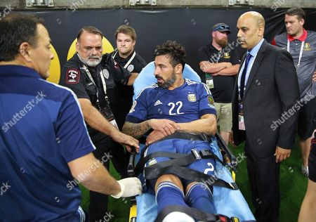 Argentina's Ezequiel Lavezzi (c) is Taken Away on a Stretcher After He was Injured in the Second Half of the Copa America Centenario Usa 2016 Cup Semifinal Match Between Usa and Argentina at the Nrg Stadium in Houston Texas Usa 21 June 2016 United States Houston