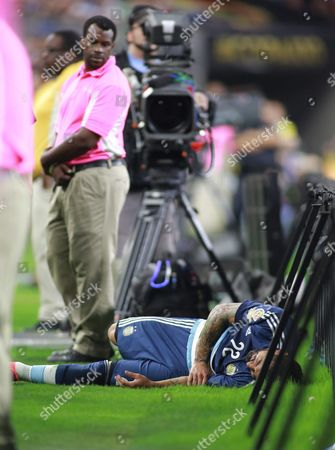 Argentina's Ezequiel Lavezzi Lies on the Ground After Getting Injured in the Second Half of the Copa America Centenario Usa 2016 Cup Semifinal Match Between Usa and Argentina at the Nrg Stadium in Houston Texas Usa 21 June 2016 United States Houston
