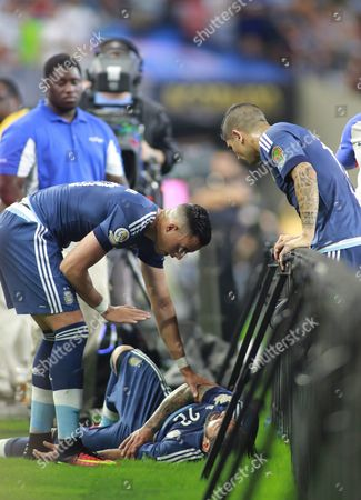 Argentina's Ezequiel Lavezzi (bottom) is Helped by His Teammates After Getting Injured in the Second Half of the Copa America Centenario Usa 2016 Cup Semifinal Match Between Usa and Argentina at the Nrg Stadium in Houston Texas Usa 21 June 2016 United States Houston