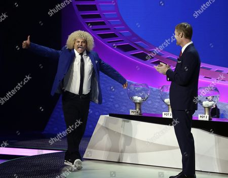 Former Colombian Soccer Player Carlos Valderrama (l) Reacts As He is Introduced in Front of Former Us Soccer Player Alexi Lalas (r) During the 2016 Copa America Centenario Official Draw at the Hammerstein Ballroom in New York New York Usa 21 February 2016 United States New York
