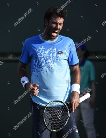 Stock Image of Jonathan Eysseric of France Reacts After a Point Against Michael Berrer of Germany During Their Tennis Match at the Bnp Paribas Open in Indian Wells California Usa 08 March 2016 United States Indian Wells