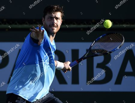 Michael Berrer of Germany Returns the Ball Against Jonathan Eysseric of France During Their Tennis Match at the Bnp Paribas Open in Indian Wells California Usa 08 March 2016 United States Indian Wells