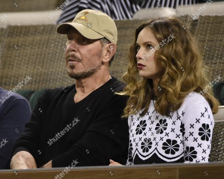 Larry Ellison Co-founder of Oracle and Tournament Owner (l) and Ukranian Actress Nikita Kahn (r) Watch the Serena Williams Versus Laura Siegemund Second Round Match at the Bnp Paribas Open in Indian Wells California Usa 11 March 2016 United States Indian Wells