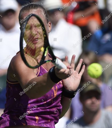 Stock Image of Kiki Bertens of the Netherlands Hits a Return Against Aleksandra Wozniak of Canada During Their Tennis Match at the Bnp Paribas Open in Indian Wells California Usa 08 March 2016 United States Indian Wells
