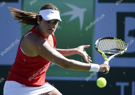 Stock Picture of Aleksandra Wozniak of Canada Hits a Return Against Kiki Bertens of the Netherlands During Their Tennis Match at the Bnp Paribas Open in Indian Wells California Usa 08 March 2016 United States Indian Wells