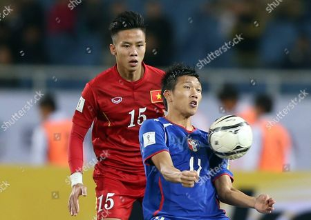 Vietnam's Que Ngoc Hai (r) and Taiwan's Wu Chun Ching (r) Vie For the Ball During a Fifa World Cup 2018 Qualifying Soccer Match Between Vietnam and Taiwan in Hanoi Vietnam 24 March 2016 Viet Nam Hanoi