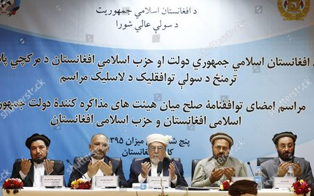 (l-r) Ata-ul Rahman Saleem Deputy Head of Afghanistan's High Peace Council Hanif Atmar Afghan National Security Advisor Peer Sayed Ahmad Gillani Head of Afghan Peace Council Mohammad Karim Amin Head of Hizb-e-islami Delegation and Ghairat Baheer the Head of Hizb-e-islami's Political Commission Pray During a Ceremony in Kabul Afghanistan 22 September 2016 According to Reports a Draft Peace Agreement Between Hizb-e-islami Led by Gulbadin Hekmatyar and the Afghan Government was Signed in Kabul on 22 September Afghanistan Kabul