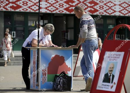 An Activist of Potential Candidate For Presidential Elections Aleksandr Lukashenko Gathers Signatures in Support of Aleksandr Lukashenko in Minsk Belarus 31 July 2015 the Presidential Elections in Belarus Will Be Held on 11 October 2015 the Poster Reads 'For the Future of Independent Belarus' Belarus Minsk