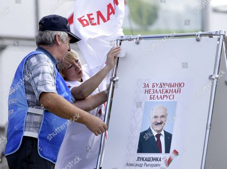 Activists of Potential Candidate For Presidential Elections Aleksandr Lukashenko Adjust His Pre-electoral Poster in Minsk Belarus 31 July 2015 the Presidential Elections in Belarus Will Be Held on 11 October 2015 the Poster Reads 'For the Future of Independent Belarus' Belarus Minsk