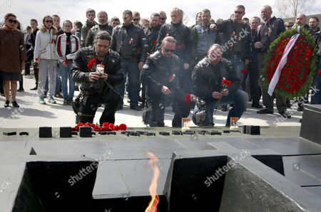 Alexander Zaldostanov (l Kneeling) Leader of the Russian Motorcycle Club 'Night Wolves' and Other Members Lay Down Flowers at the Khatyn Memorial Complex in Khatyn Some 60 Kilometers From Minsk Belarus 30 April 2016 During the Club's Rally From Moscow to Berlin Called 'Victory Roads - to Berlin' the Annual Motorcycle Rally Marking the 71st Anniversary of Victory Over Nazi-germany in Wwii Lasts For 14 Days and Covers a Distance of About 6 000 Kilometers Belarus Khatyn
