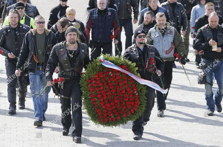 Alexander Zaldostanov (c-l) Leader of the Russian Motorcycle Club the Night Wolves with His Club-mates Carries a Wreath to the Mount of Glory Monument on the Outskirts of Minsk During Their Rally From Moscow to Berlin 'Victory Roads - to Berlin' Belarus 30 April 2016 the Annual 'Victory Roads - to Berlin' Motorcycle Rally Marking the 71st Anniversary of Victory Over the Nazi Germany in Wwii Lasts For 14 Days and Covers 6 000 Km Belarus Minsk