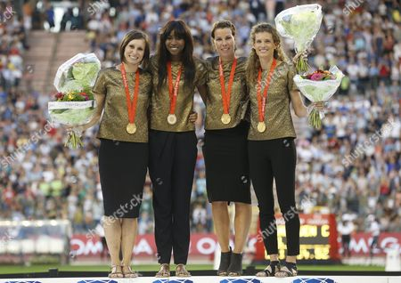 (l-r) Belgium's Kim Gevaert Elodie Ouedraogo Hanna Marien and Olivia Borlee Receive From the International Commitee the 2008 Womens 4x100m Relay Gold Medal From Beijing Olympics Competition at the Memorial Van Damme Iaaf Diamond League International Athletics Meeting at King Baudouin Stadium in Brussels Belgium 09 September 2016 Belgium Brussels