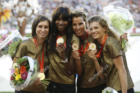 Stock Picture of (l-r) Belgium's Kim Gevaert Elodie Ouedraogo Hanna Marien and Olivia Borlee Receive From the International Commitee the 2008 Womens 4x100m Relay Gold Medal From Beijing Olympics Competition at the Memorial Van Damme Iaaf Diamond League International Athletics Meeting at King Baudouin Stadium in Brussels Belgium 09 September 2016 Belgium Brussels