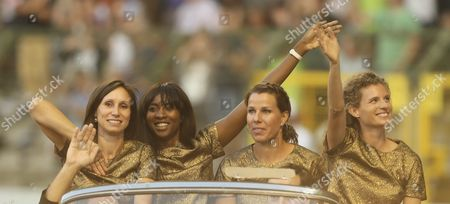 Stock Image of (l-r) Belgium's Kim Gevaert Elodie Ouedraogo Hanna Marien and Olivia Borlee Receive From the International Commitee the 2008 Womens 4x100m Relay Gold Medal From Beijing Olympics Competition at the Memorial Van Damme Iaaf Diamond League International Athletics Meeting at King Baudouin Stadium in Brussels Belgium 09 September 2016 Belgium Brussels