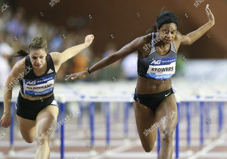 Stock Photo of Jasmin Stowers (r) of the Usa in Action on Her Way to Win the Women's 100m Hurdles Competition Next to German Nadine Hildebrand (l) at the Memorial Van Damme Iaaf Diamond League International Athletics Meeting at King Baudouin Stadium in Brussels Belgium 09 September 2016 Belgium Brussels