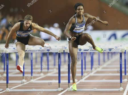 Jasmin Stowers (r) of the Usa in Action on Her Way to Win the Women's 100m Hurdles Competition Next to German Nadine Hildebrand (l) at the Memorial Van Damme Iaaf Diamond League International Athletics Meeting at King Baudouin Stadium in Brussels Belgium 09 September 2016 Belgium Brussels