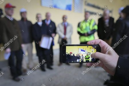 A Person Photographs a Group of Employees of the European Institutions with a Petition of 151 000 Signatures Called #ethics4eu in Front of the Eu Commission Headquarters in Brussels Belgium 12 October 2016 the Petition is Calling For a Suspension of Pension Rights to Former European Commission President Jose Manuel Barroso For Taking a Job at Us Bank Goldman Sachs As Advisor and Non-executive Chairman of Its International Business Belgium Brussels