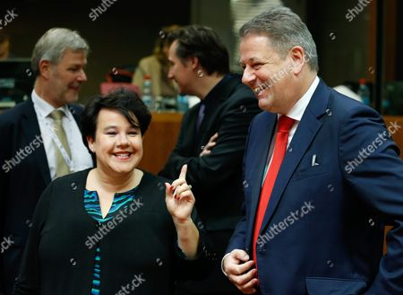 Austrian Environment Minister Andrae Rupprechter (r) and Dutch State Secretary of the Ministry of Infrastructure and the Environment Sharon Dijksma (l) Chat at the Start of an European Environment Council Meeting in Brussels Belgium 16 December 2015 Belgium Brussels