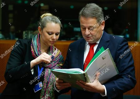 Austrian Environment Minister Andrae Rupprechter (r) and Luxembourg's Environment Minister Carole Dieschbourg (l) Check a Document at the Start of an European Environment Council Meeting in Brussels Belgium 16 December 2015 Belgium Brussels