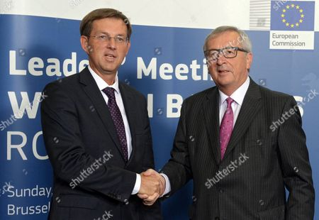 Slovenian Prime Minister Miroslav Cerar (l) is Welcomed by European Commission President Jean-claude Juncker (r) at the Start of a Small Summit of Leaders to Discuss Refugee Flows Along the Western Balkans Route at Eu Commission Headquarters in Brussels Belgium 25 October 2015 President Juncker Convened the Leaders of the Countries Concerned and Most Affected by the Emergency Situation Along the Western Balkans Route the Aim of the Summit is to Improve Cooperation and Step Up Consultation Between the Countries Along the Route and Decide on Pragmatic Operational Measures That Can Be Implemented Immediately to Tackle the Refugee Crisis in That Region Belgium Brussels
