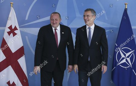 Stock Image of President of Georgia Guiorgui Margvelachvili (l) is Welcomed by Nato Secretary General Jens Stoltenberg Prior to a Meeting at Alliance Headquarters in Brussels Belgium 08 June 2016 Belgium Brussels