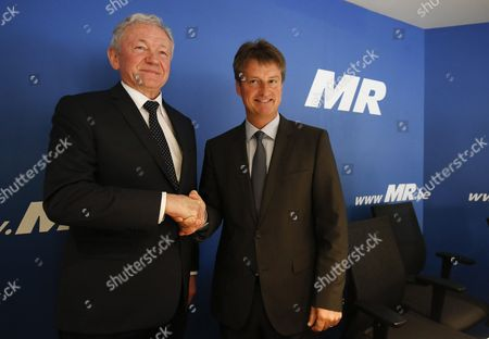 Stock Image of New Belgian Transport Minister Francois Bellot (l) and Mouvement Reformateur (mr) Party Chairman Olivier Chastel (r) Shake Hands During a News Conference in Brussels Belgium 17 April 2016 Francois Bellot is Replacing Jacqueline Galant who Resigned From Her Post After a Report on Airport Security Following the Brussels Terror Attacks of 22 March Belgium Brussels